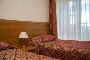 Кровать или кровати в номере Отель Переславль