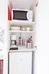 A kitchen or kitchenette at Forenom Aparthotel Lahti