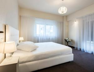 A bed or beds in a room at Orhideea Residence & Spa