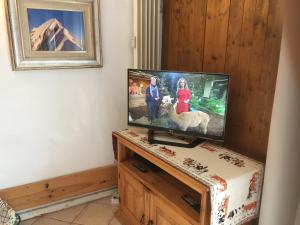 A television and/or entertainment center at Chamonix Centre Holiday Sauna Apartment 2