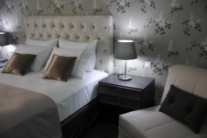 Ένα ή περισσότερα κρεβάτια σε δωμάτιο στο Theasis Hotel Paramythia