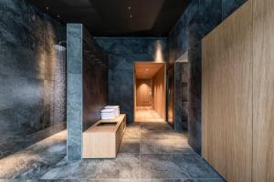 A bathroom at Boutique & Gourmet Hotel Orso Grigio