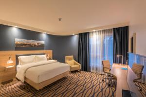 A bed or beds in a room at Hampton By Hilton Frankfurt Airport