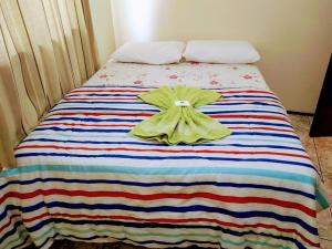 A bed or beds in a room at Hotel Do Oeste