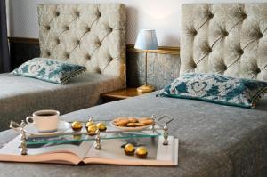 Lova arba lovos apgyvendinimo įstaigoje Ursula Royal Apartments