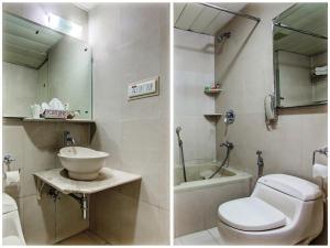 A bathroom at Sai Vishram Business Hotel