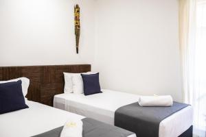 A bed or beds in a room at Beachfront Hideaway - Port Douglas