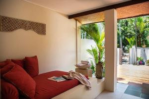 A seating area at Beachfront Hideaway - Port Douglas