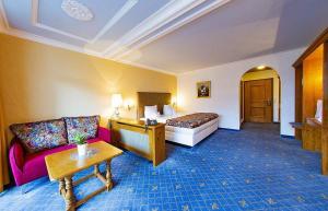 Ein Bett oder Betten in einem Zimmer der Unterkunft Hotel Reiterhof