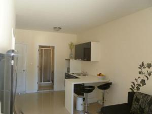A television and/or entertainment centre at Apartments Amfora