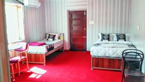 A bed or beds in a room at Sanee Grace Madikeri