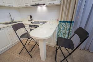 Кухня или мини-кухня в Апартаменты Лотте 24