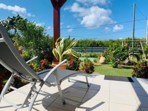 Balcon ou terrasse dans l'établissement Les Palmes du Moulin