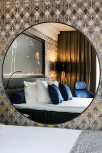 Uma área de estar em American Hotel Amsterdam