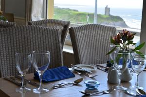 A restaurant or other place to eat at The Cliff House Hotel
