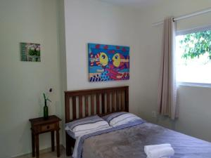 A bed or beds in a room at Encantada Floripa 2
