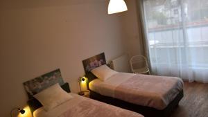 Säng eller sängar i ett rum på Bambou & Olivier Chambres d'Hôtes