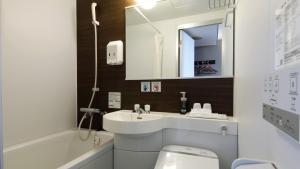 A bathroom at Kumamoto Green Hotel