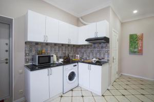 A cozinha ou cozinha compacta de Leyla Apartments 6 At Fountain Square
