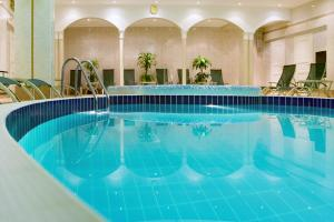 The swimming pool at or near Moscow Marriott Grand Hotel