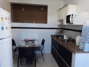 A kitchen or kitchenette at Excelente Casa Temporada em Aracaju