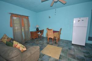 A seating area at Lamblion Holiday Apartment