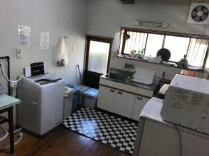 A kitchen or kitchenette at Minshuku Nodoka