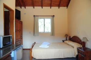 A bed or beds in a room at Corazon de Montaña