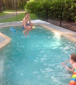 The swimming pool at or near Mistinthegumtrees Eco Luxury Cabins