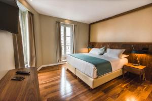 A bed or beds in a room at Rossio Boutique Hotel