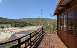 A balcony or terrace at Gourits River Guest Farm