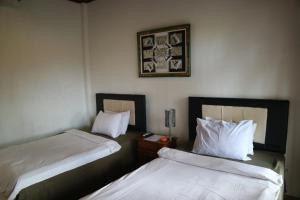 A bed or beds in a room at Bima Sakti House Canggu