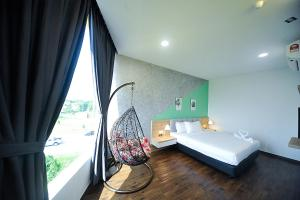 A bed or beds in a room at MYe Hotel
