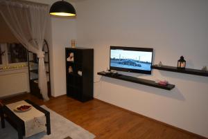 TV a/nebo společenská místnost v ubytování MM Apartments 10 min from center