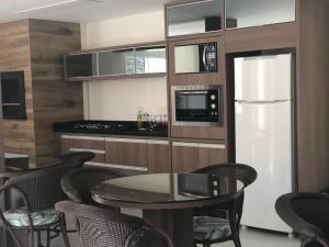 A kitchen or kitchenette at RESIDENCIAL FAGUNDES II