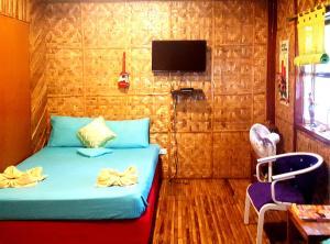 Ein Bett oder Betten in einem Zimmer der Unterkunft MJ Room Rental
