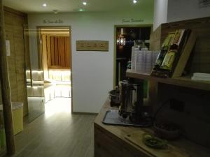 A kitchen or kitchenette at Hotel Denny