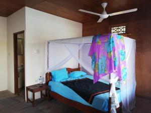 Ein Bett oder Betten in einem Zimmer der Unterkunft allan Bungalow