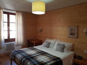 Letto o letti in una camera di Hotel Pedretti