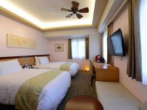 ホテルパームロイヤル NAHA 国際通りにあるベッド