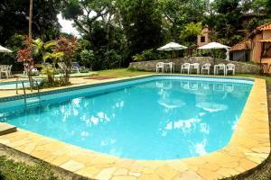 The swimming pool at or near Pousada O Casarão