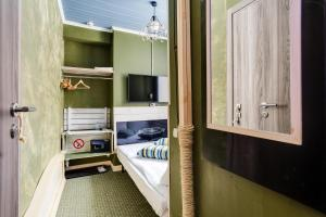 A bed or beds in a room at Loft Hotel H11