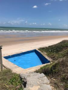 The swimming pool at or near CASA À BEIRA MAR EM PRAIA DE CAMPINA