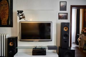 A television and/or entertainment center at Imperial Suite La Lizza