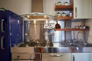 A kitchen or kitchenette at Imperial Suite La Lizza