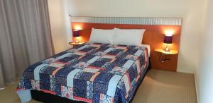 A bed or beds in a room at Noosa Holiday Accommodation