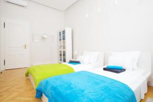 A bed or beds in a room at Apartment Marmonaut
