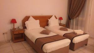 A bed or beds in a room at Hotel El Biar