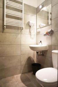 A bathroom at Expolis Residence - City Center Poznań Główny - 24 Reception