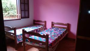 A bed or beds in a room at Rancho do Toninho